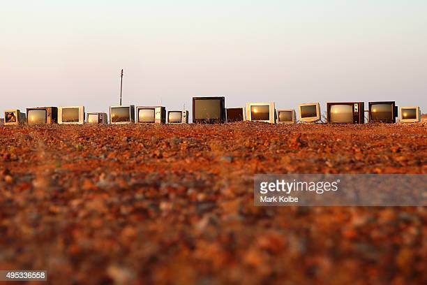 A display of television and computer screens is seen on the roadside outside of town on October 21 2015 in Coober Pedy Australia