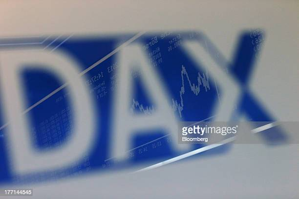 Display of the DAX Index curve is reflected in a sign on the trading floor at the Frankfurt Stock Exchange in Frankfurt, Germany, on Wednesday, Aug....