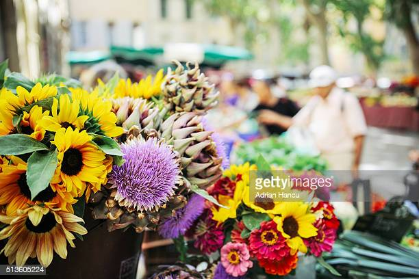 Display of various flowers on market stall