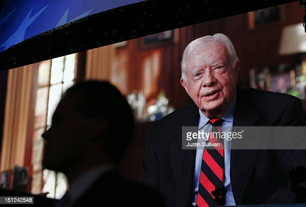 A display on stage shows former US President Jimmy Carter during day one of the Democratic National Convention at Time Warner Cable Arena on...