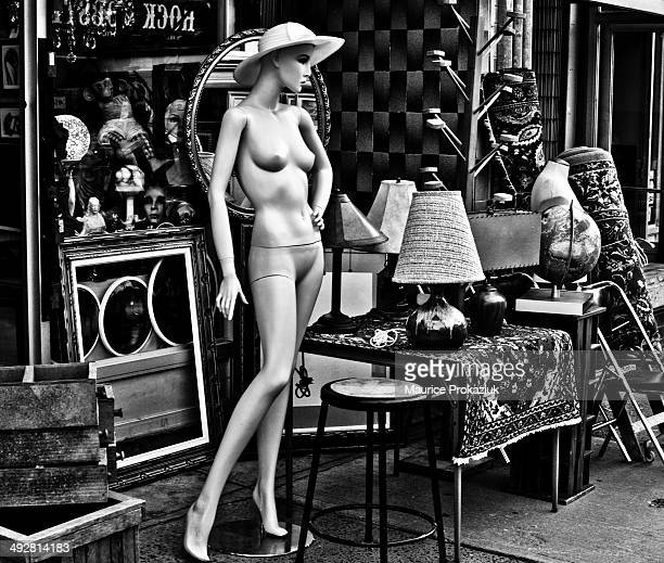 CONTENT] Display outside an antique store The mannequin with only a hat caught my eye for this shot