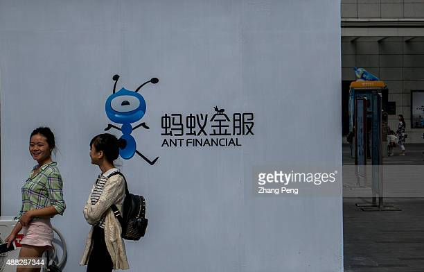 A display poster of Ant financial on the downtown street In August Alibabas Ant Financial has just launched an integrated wealth management app...