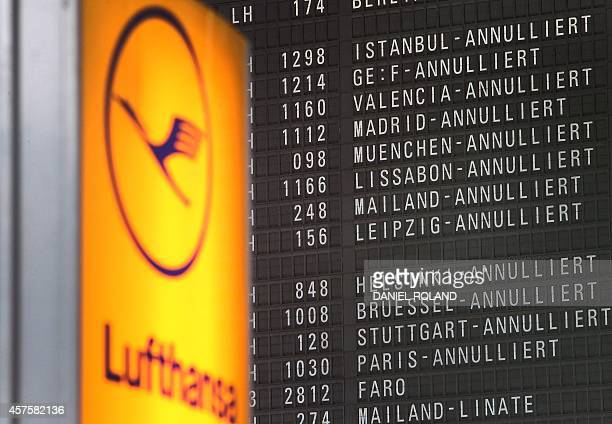 Display showing cancelled flights due to a strike of pilots of German airline Lufthansa is pictured at the airport in Frankfurt am Main, Germany, on...