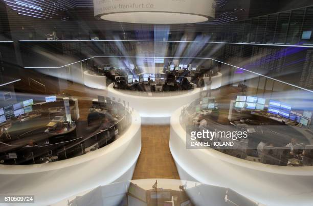 A display showing the German Stock Market Index DAX is pictured at the stock exchange in Frankfurt Germany on September 26 after shares in Deutsche...