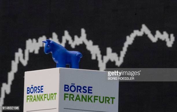 A display showing the German stock market index DAX is pictured at the stock exchange in Frankfurt am Main western Germany on February 6 2018 The DAX...