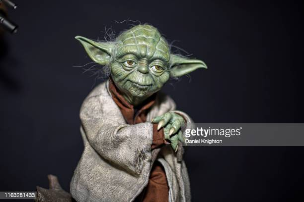 """Display statue of Yoda from """"Star Wars"""" at 2019 Comic-Con International on July 20, 2019 in San Diego, California."""