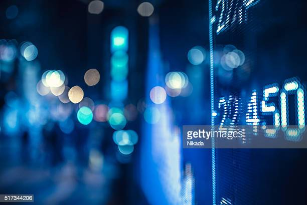 display stock market numbers and graph - interest rate stock pictures, royalty-free photos & images