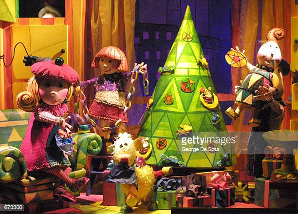 A display window in front of Saks Fifth Avenue reveals a Christmas scene November 25 2001 in New York City