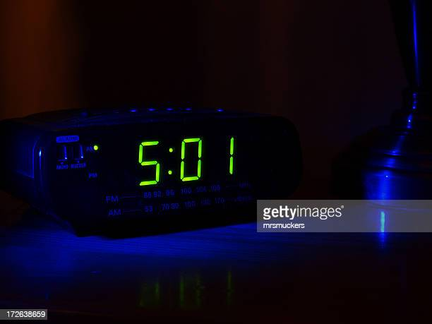 501 displayed on a clock in a dark room - alarm clock stock pictures, royalty-free photos & images