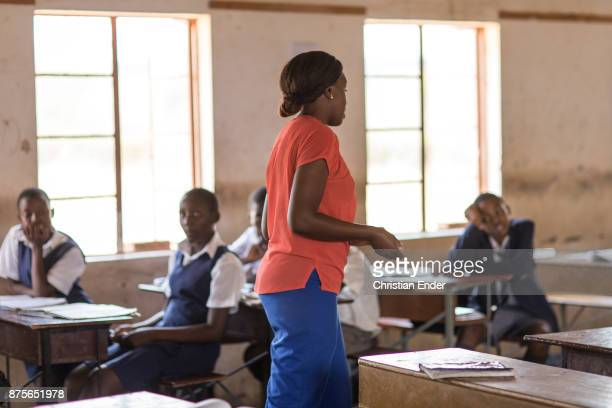 Displaying a young teacher joining a lesson with the pupils inside a school in a rural area near Chakari.