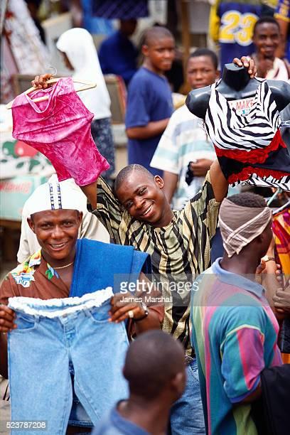 displaying clothing in nigerian market - lagos stock-fotos und bilder