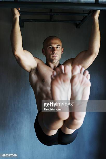 displaying his brute strength - beautiful male feet stock photos and pictures