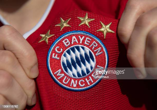 Displaying the FC Bayern Munich club crest on the first team home shirt on March 7, 2021 in Manchester, United Kingdom.
