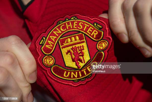 Displaying the Manchester United club crest on the first team home shirt on March 7, 2021 in Manchester, United Kingdom.