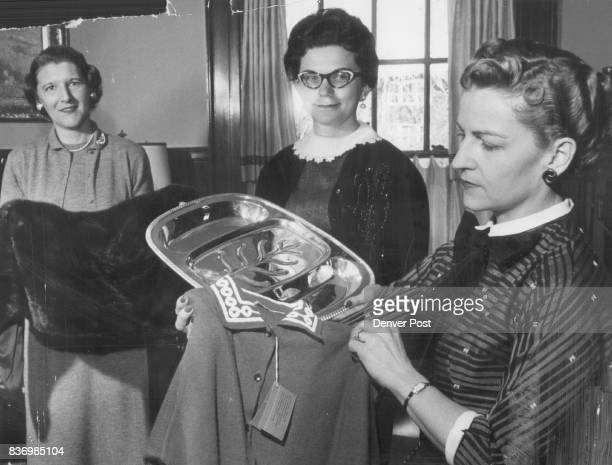 Displaying the mink capelet silver tray and trimmed sweater to be given away to the Tiara ball on May 11 are Mrs Theodore Wrenn Jr Mrs Donald...