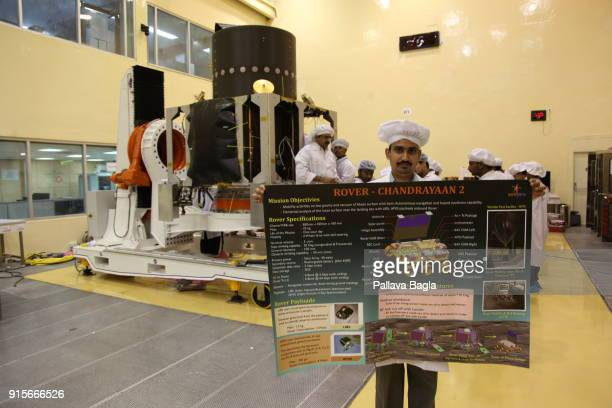 Displaying the poster on Chandrayaan2 near the satellite The Indian Space Research Organisation or ISRO is putting finishing touches to India's...
