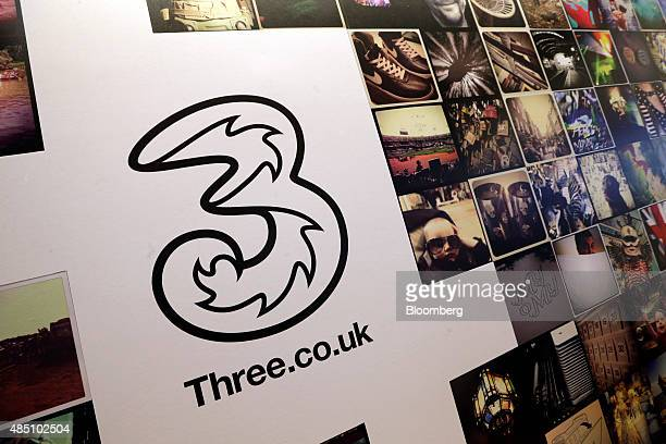 Displays feature the Three logo at a Three store operated by Hutchison Whampoa Ltd in London UK on Monday Aug 24 2015 Telefonica SA agreed to sell...