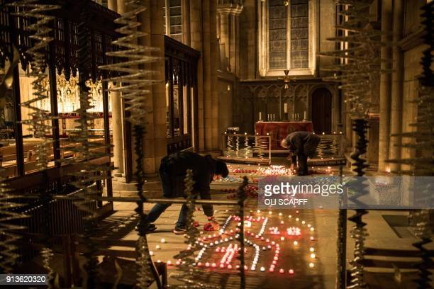 Displays of candles are lit prior to the Candlemas Festal Eucharist service at Ripon Cathedral in Ripon northern England on February 2 2018 The...