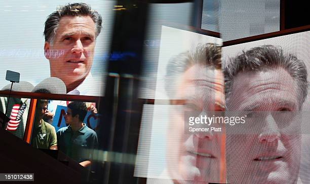 Displays show Republican presidential candidate former Massachusetts Gov Mitt Romney during the final day of the Republican National Convention at...