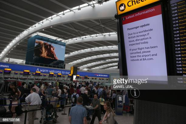 A displays warms passengers to 'Expect Disruption' inside Terminal 5 of London's Heathrow Airport on May 29 2017 Passengers faced a third day of...
