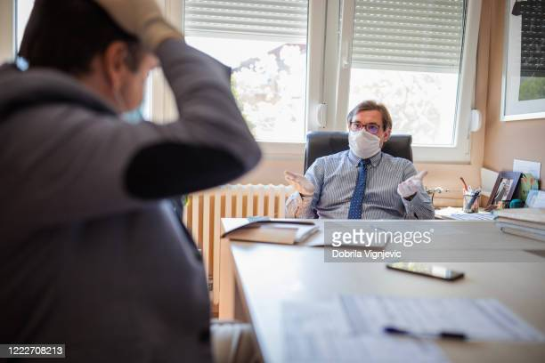 displeased business men realizing their business is being affected by corona virus - dismissal cricket stock pictures, royalty-free photos & images