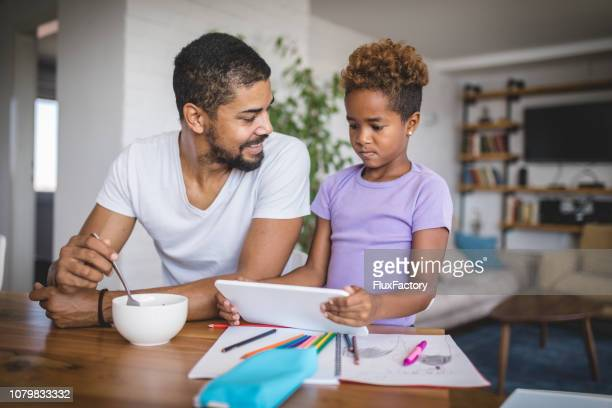 displeased daughter and a smiling father drawing together in the morning - furious stock pictures, royalty-free photos & images