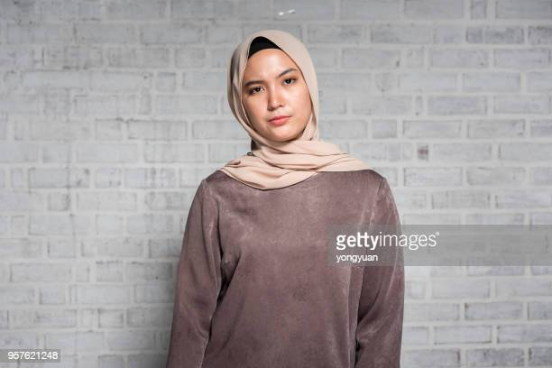 displeased malaysian woman - malay hijab stock photos and pictures