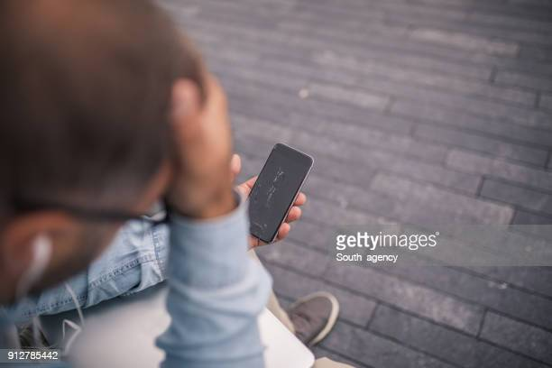 displeased man with broken smartphone - shattered glass stock pictures, royalty-free photos & images