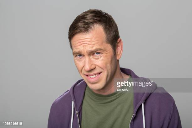 displeased mature man - khaki stock pictures, royalty-free photos & images