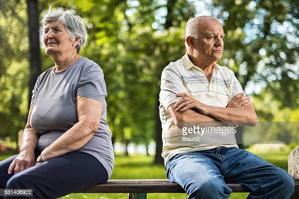 Displeased old couple having problems in their marriage.