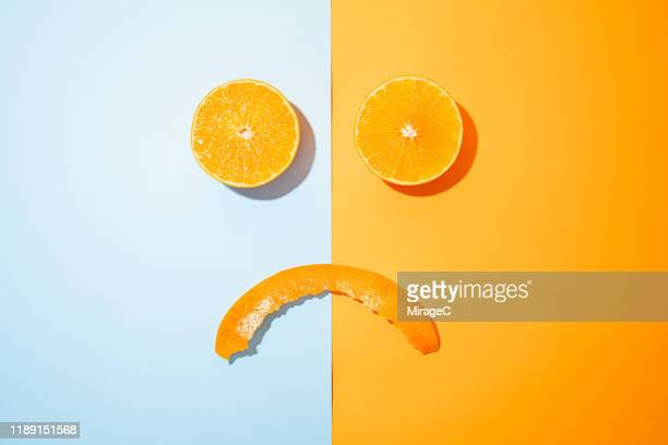 displeased orange - good; times bad times stock pictures, royalty-free photos & images