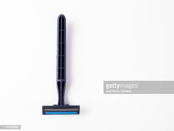 disposable blue razor on a white background - schaamhaar stockfoto's en -beelden