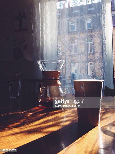 Disposable Coffee Cup And Jar On Table At Home