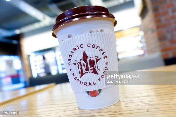 A disposable coffee cup with a plastic lid is pictured inside a branch of Pret A Manger in London on November 17 2017 / AFP PHOTO / Justin TALLIS