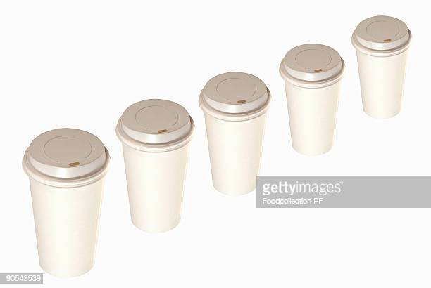 Disposable coffee cups on white background, close up