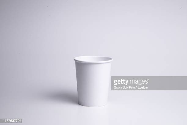 disposable cup against white background - disposable cup stock pictures, royalty-free photos & images