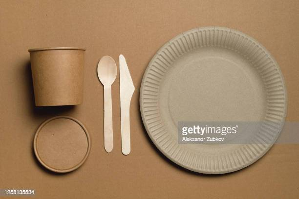 disposable eco-friendly tableware made of recycled material, on a beige background or table. food industry. - single use stock pictures, royalty-free photos & images