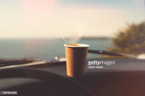 disposable paper coffee cup on dashboard - car stock pictures, royalty-free photos & images