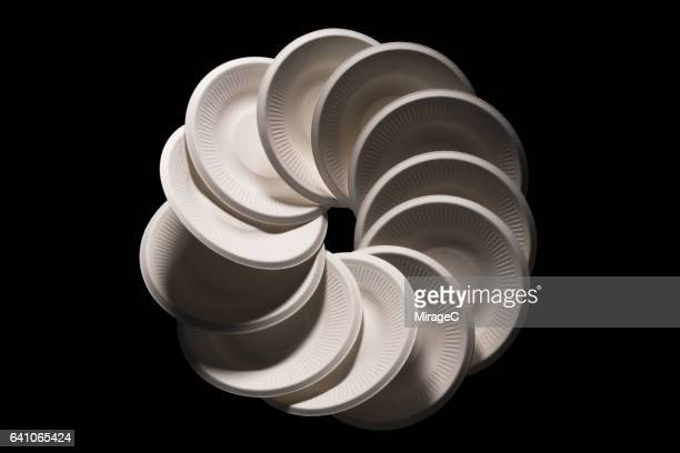 disposable white paper plates circle shape stacking - paper plate stock photos and pictures