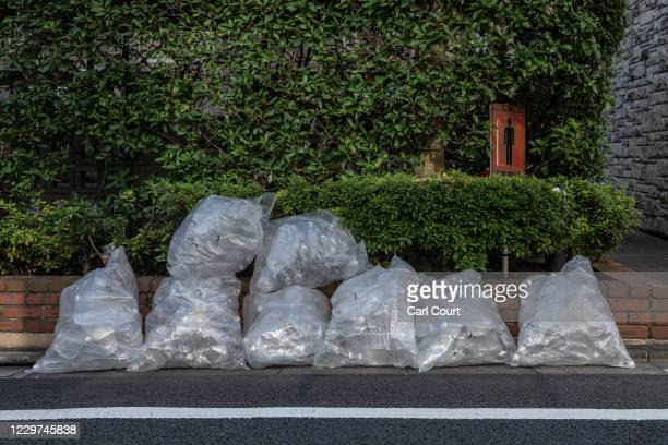 Disposed polyethylene terephthalate plastic bottles are placed outside an apartment block for collection on November 19 2020 in Tokyo Japan Despite...