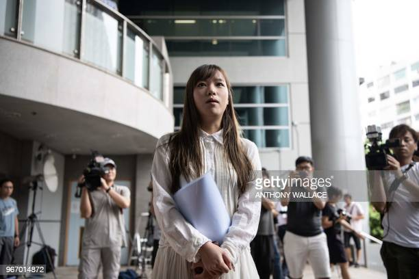 Disqualified proindependence lawmaker Yau Wai Ching arrives at the Kowloon City Magistrates Court in Hong Kong on June 4 before her sentencing after...