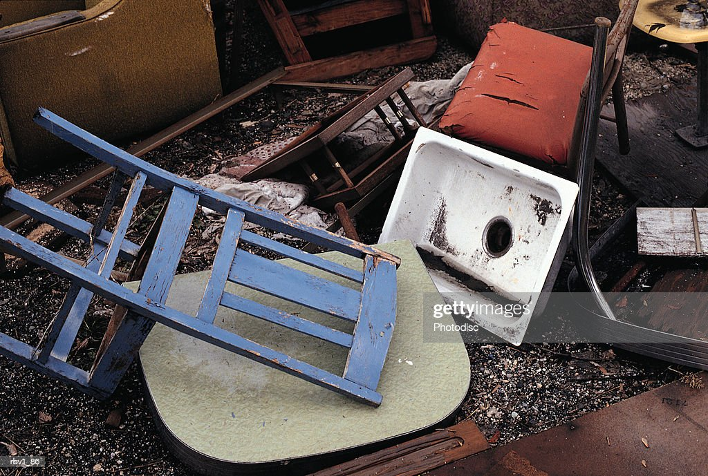 disregarded furniture forms garbage piles of chairs and sinks : Foto de stock