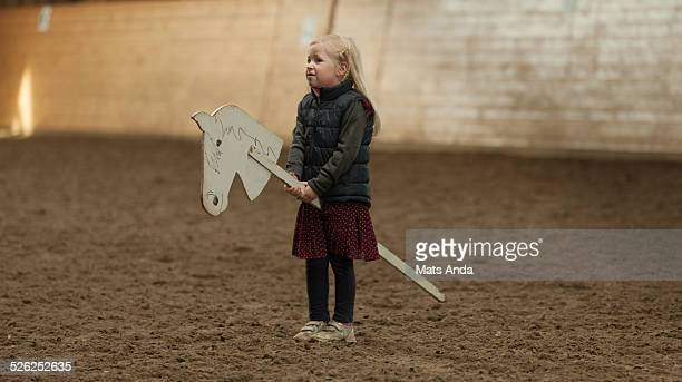 Dissapointed girl on a makeshift horse