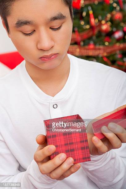 Dissapointed male with christmas present