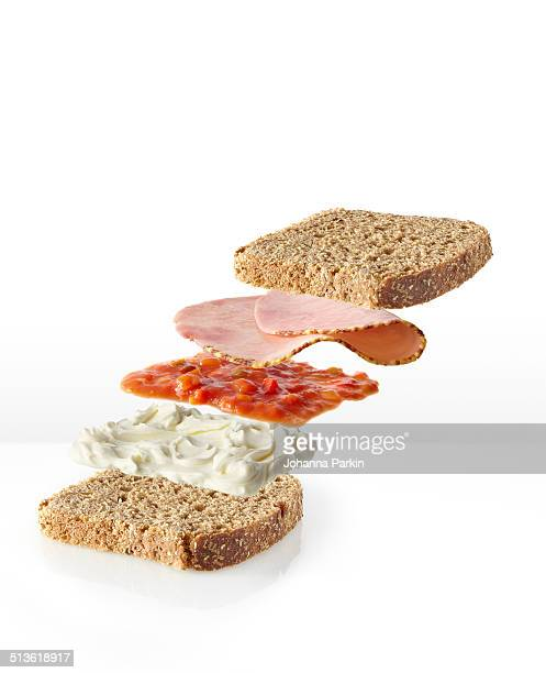 Dissected ham sandwich on brown bread