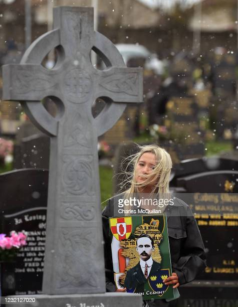 Dissident republican supporter stands in Derry City cemetery during a 1916 wreath laying event as snow falls on April 5, 2021 in Londonderry,...