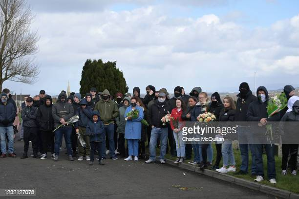 Dissident republican supporters listen to speeches in Derry City cemetery's republican plot during a 1916 wreath laying event on April 5, 2021 in...