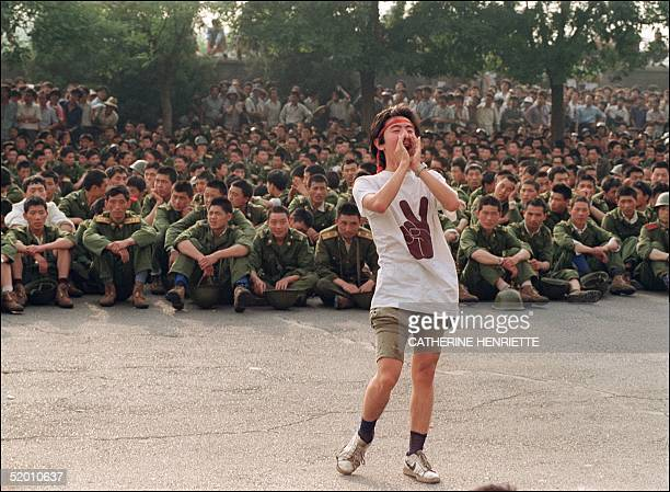 A dissident student asks soldiers to go back home as crowds flooded into the central Beijing 03 June 1989 On the night of 03 and 04 June 1989...