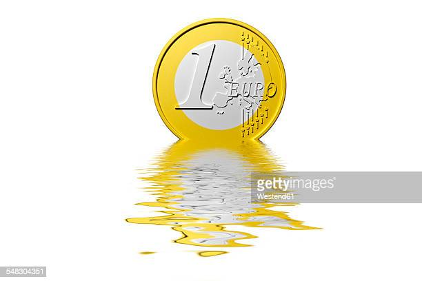 dissolving euro coin - monetary policy stock pictures, royalty-free photos & images