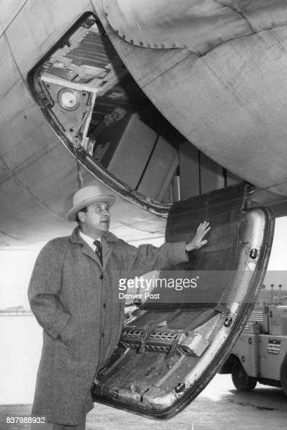 Dist Att Bert Keating at the rear cargo hale on W DC6B Credit Denver Post